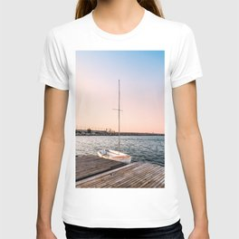 Mediterranean sunset over a wooden jetty with sailing boat T-shirt