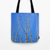 climbing Tote Bags featuring Climbing by Emma Deer