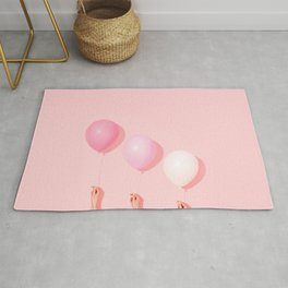 Three balloons in blush Rug