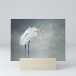 Egret in winter breeze Mini Art Print