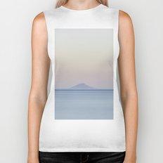 Island silhouette on horizon at sunset Biker Tank
