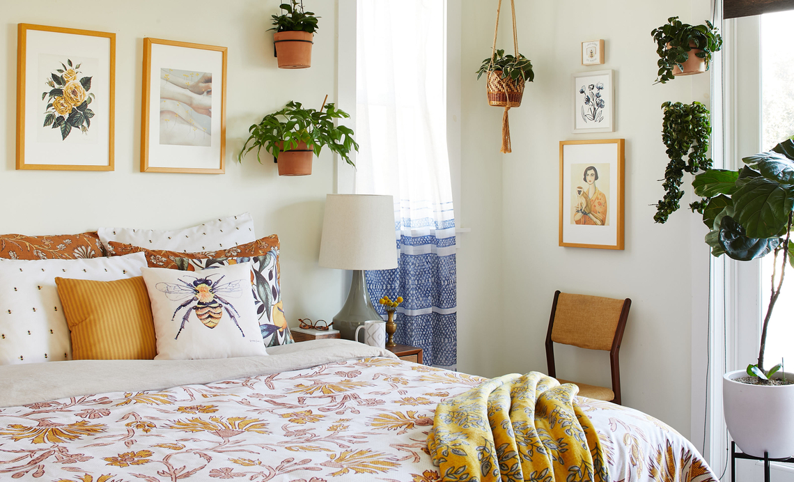 bedroom with yellow floral comforter