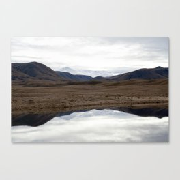Reflections of the Rolling Hills and Snow-Covered Mountains on the Road to Edoras Canvas Print