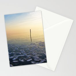 Fishing net stick in calm frozen water Stationery Cards