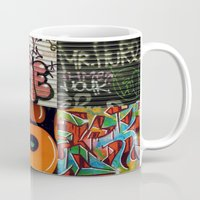 grafitti Mugs featuring grafitti collage by laika in cosmos