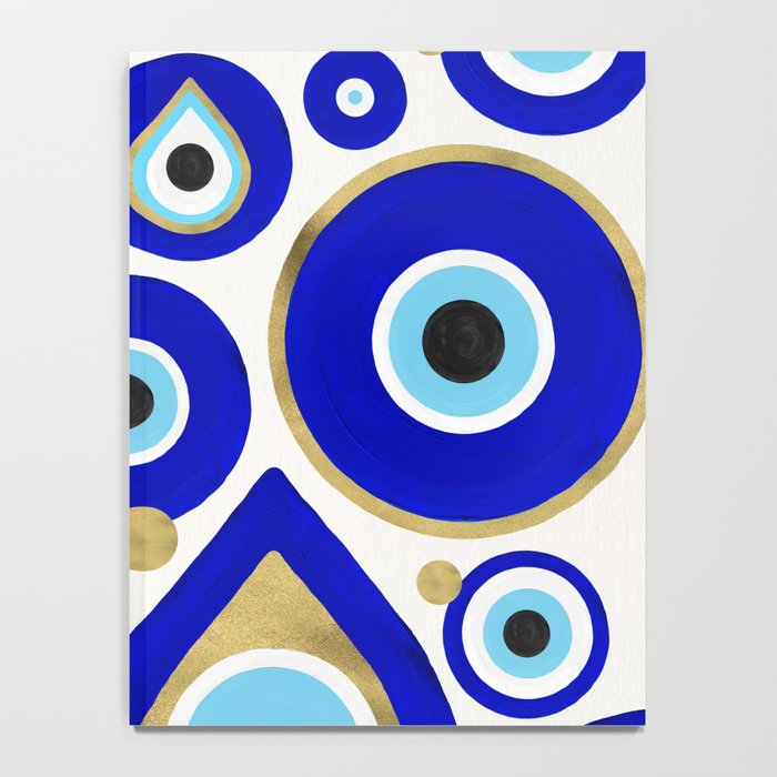 Evil Eye Charms on White Notebook