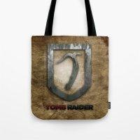 tomb raider Tote Bags featuring Tomb Raider by Liquidsugar