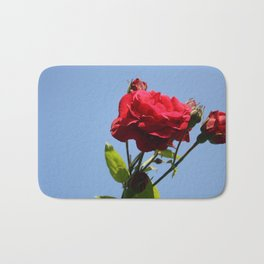 Red Roses with Blue Sky Background Bath Mat