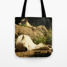 Sleeping white wolf in the summer sun Tote Bag