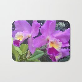 Purple and yellow orchids Bath Mat