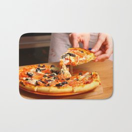 Woman hands sliced pizza. Bath Mat
