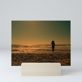 woman on the beach Mini Art Print