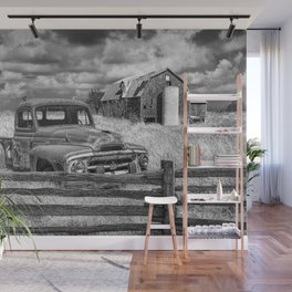 Black and White of Rusted International Harvester Pickup Truck behind wooden fence with Red Barn in Wall Mural