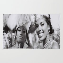Black and white photograph of costume girls at toronto caribana street party Rug