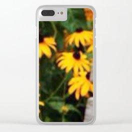 Seat in the park with yellow flowers Clear iPhone Case