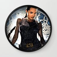 lara croft Wall Clocks featuring Angelina Jolie as Lara Croft by Brian Raggatt
