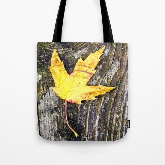 a leaf on a board Tote Bag
