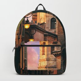 BROWN AND GRAY CONCRETE BUILDING DURING GOLDEN HOUR Backpack