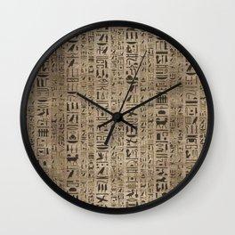 Egyptian hieroglyphs on wooden texture Wall Clock