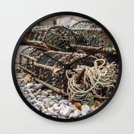 Fishing gear on a Norfolk beach Wall Clock