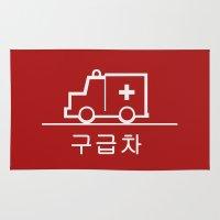 korea Area & Throw Rugs featuring Ambulance - Korea by Crazy Thoom