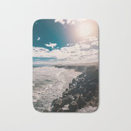 Coast, stones and clouds over the sea Bath Mat