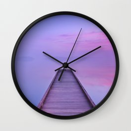 Jetty on a still lake at dawn in The Netherlands Wall Clock