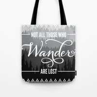 not all those who wander are lost Tote Bags featuring Not All Those Who Wander Are Lost by Fercute