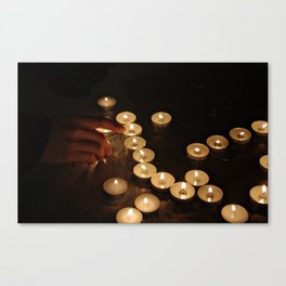 Lit Candles Canvas Print
