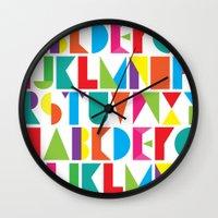 alphabet Wall Clocks featuring Alphabet by Rachel Lee