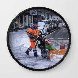 Ploughing the snow Wall Clock