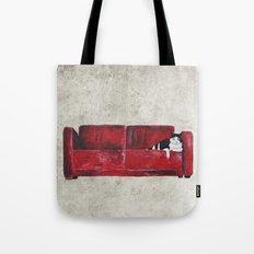 cat in a red sofa  Tote Bag