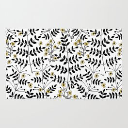 Branches with flowers in black and yellow Rug