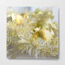 Christmas tinsel and baubles in gold Metal Print