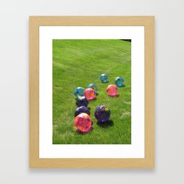 Colorful balls on the grass  Framed Art Print