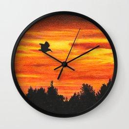 Sunset sky with bird Wall Clock