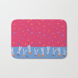St. Valentine's Day Pattern. Pink pattern, on the blue field, white bunny hold blue and yellow heart Bath Mat
