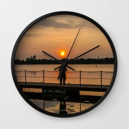 Angler on the river Wall Clock