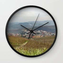 Scenic view of the freshly harvested grape fields in autumn in Barolo valley Wall Clock
