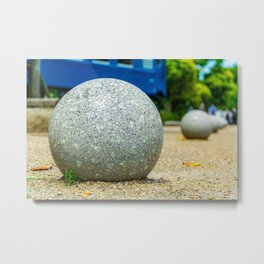 Grey Stone Ball In A Park Metal Print