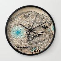 the thing Wall Clocks featuring Thing. by Bläckbeärd