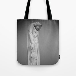Statue in the mist Tote Bag