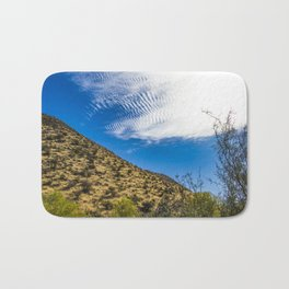 Clouds Stretching Across a Deep Blue Sky in the Anza Borrego Desert, California, USA Bath Mat