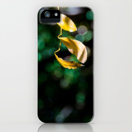 Yellow leaves in colorful bokeh iPhone Case