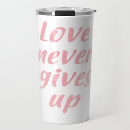Love never gives up Travel Mug
