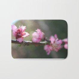 A Bough Of Blurred Peach Blossom Bath Mat