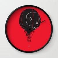 hot air balloon Wall Clocks featuring Hot Air Balloon Skull by Fupete Art