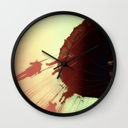 Swings and Light Leaks Wall Clock