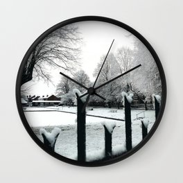 bowl green on snow day Wall Clock