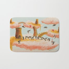 a celebration of penguins in the clouds Bath Mat